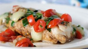 Pan fried cod with spinach and cherry tomatoes
